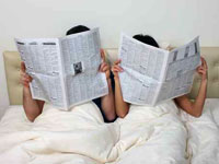 couple-bed-newspaper
